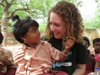 Volunteer and Child in India